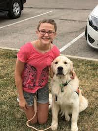 Hannah Westmoreland with her service dog, Journey.(Westmoreland family)