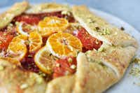 Rustic citrus galette gets a sprinkling of sugar for sweetness and a scattering of pistachios to add crunch. (Ben Torres/Special Contributor)