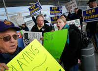 EPA worker and AFGE Local 1003 member Sarah Frey leads union and federal airport employees in a protest of the government shutdown outside of Terminal D at DFW International Airport, Wednesday, January 16, 2019. Also joining her is Texas State Employees Union retiree Kenneth Stretcher (left) and AFL-CIO Central Labor Council COO Mark York (center). (Tom Fox/Staff Photographer)