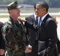 President Barack Obama spoke with Navy Vice Admiral William McRaven, commander of Joint Special Operations Command, at Fort Campbell, Ky., in May 2011, just days after McRaven led operational control of Navy SEAL Team Six's successful mission to get Osama bin Laden.(File Photo/The Associated Press)