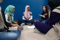 "<p><span style=""font-size: 1em; background-color: transparent;"">Lauren Harper, a Cadette in Girl Scout Troop 882 (second from right), tells Amsah Kazmi (right) and (from left) Omera Wahid, Asiya Mohammed and Assiya Hayredin of Girl Scout Troop 647 that she'd bring turkey bacon if they went on a camping trip. The Scouts were working on their Finding Common Ground Badge.</span></p>(Daniel Carde/Staff Photographer)"