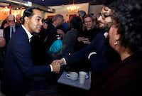 Julian Castro, former U.S. Secretary of Housing and Urban Development and a candidate for the 2020 Democratic presidential nomination, shook hands during a campaign gathering at a shop in Somersworth, N.H., on Tuesday, Jan. 15, 2019.(Charles Krupa/The Associated Press)