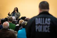 """A Dallas Police officer listens as Walter """"Changa"""" Higgins addresses a Citizens Police Review Board town hall meeting at Highland Oaks Church of Christ on Thursday, Jan. 3, 2019, in Dallas.(Smiley N. Pool/Staff Photographer)"""