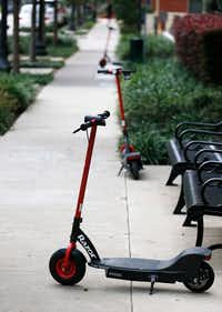 Razor electric scooters on the sidewalk in Uptown.(Vernon Bryant/Staff Photographer)