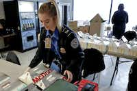 TSA officer Jenna Erickson, left, helps arrange boxes of meals at the TSA break room, Friday, Jan. 18, 2019, at the Pittsburgh International Airport in Imperial, Pa. Because of the partial government shutdown, the restaurant has donated meals to the TSA workers. (Keith Srakocic/AP)