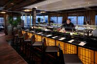 """<p>A member of the crew works at Nami Sushi aboard the<span style=""""font-size: 1em; background-color: transparent;"""">Nieuw Statendam.</span></p>(Holland America Line/Courtesy)"""
