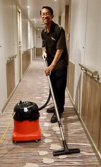 "<p><span style=""font-size: 1em; background-color: transparent;"">Cabin steward Budhi Prasetyo vacuums the hallway daily after he and his partner have made up 29 cabins aboard the Nieuw Statendam.</span></p>(Robert N. Jenkins/Special Contributor)"
