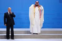 In this Nov. 30, 2018 photo, Russian President Vladimir Putin and Crown Prince Mohammed bin Salman of Saudi Arabia wait for the G20 group photo in Buenos Aires, Argentina. All eyes were on the Saudi crown prince at the Group of 20 summit as he made his first major overseas appearance since the killing of a dissident journalist in his country's consulate in Istanbul.(Ricardo Mazalan/The Associated Press)