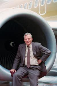 Southwest Airlines CEO Herb Kelleher photographed sitting on an engine in 1991. (David Woo/The Dallas Morning News)