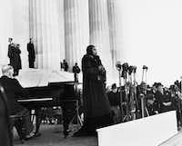 """<p><span style=""""font-size: 1em; background-color: rgb(255, 255, 255);"""">Marian Anderson (center), shown performing at the Washington Memorial in April 1939, won the first scholarship from the</span><span style=""""font-size: 1em; background-color: transparent;"""">National Association of Negro Musicians in 1919. Today, young singers compete for the same honor in the Marian Anderson Vocal Arts Competition.</span></p>(The Associated Press/File Photo)"""