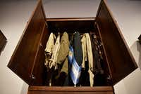 """<p>A vintage closet is filled with clothing items from Argentina at the art exhibition. The wardrobe represents <br>Argentine dictator&nbsp;<span style=""""font-size: 1em; background-color: transparent;"""">Jorge Rafael Videla and victims of his regime.&nbsp;</span></p>(Ben Torres/Special Contributor)"""