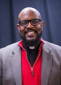 The Rev. Dr. Michael Waters of Agape/Joy Tabernacle African Methodist Episcopal Churches posed for a photo Wednesday, Jan. 23, 2019. (Ashley Landis/Staff Photographer)