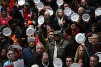 Furloughed federal workers and supporters protested the partial government shutdown inside the Hart Senate Office Building Jan. 23 in Washington, D.C.The protesters wrote messages on paper plates. (Win McNamee/Getty Images)