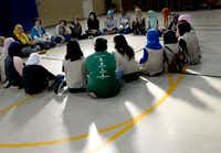 Girl Scouts from Troop 882 and Troop 5309 (both non-Muslim), and Troop 647, a Muslim troop, listen to Troop 647 leader Sharmina Zaidi, far left in yellow, as they begin their combined meeting at the Islamic Association of North Texas mosque in Richardson, Texas on Saturday, November 3, 2018. (Daniel Carde/Staff Photographer)
