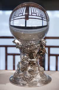 A crystal sphere is a personal favorite of Trammell S. Crow, president of the Crow Family Foundation and the son of Margaret and Trammell Crow.(Rose Baca/Staff Photographer)