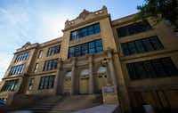 The north entrance of the old Dallas High School building, right, on Thursday, July 27, 2017 on Bryan Street in downtown Dallas.(Ashley Landis/Staff Photographer)