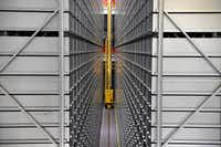 BookBot, a robotic delivery system at North Carolina State University's Hunt Library, enables the library to hold 2 million books in one-ninth the space of traditional stacks.(Katherine Frey/The Washington Post)
