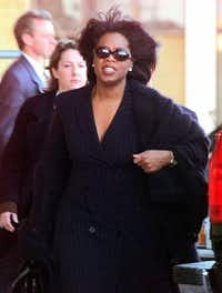 Oprah Winfrey leaves the federal courthouse after the jury was dismissed for the day in Amarillo on Feb. 25, 1998. Cattlemen alleged that an April 1996 Oprah show made mad-cow disease sound like an imminent threat to beef-eaters and caused the cattle market to plunge to 10-year lows. (LM Otero/The Associated Press)
