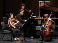 Ayano Ninomiya on violin (left), Alexandre Moutouzkine on piano and Clancy Newman on cello perform Paul Schoenfield's <i>Cafe Music</i>&nbsp;during a Chamber Music International concert at Moody Performance Hall on Jan. 26, 2019.&nbsp;(Rex C. Curry/Special Contributor)