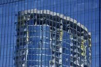 A luxury apartment tower under construction in the Legacy West area of Plano is reflected off another nearby building.(Nathan Hunsinger/Staff Photographer)