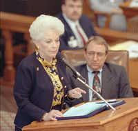 Gov. Ann Richards, flanked by Speaker of the House Pete Laney, goes over specific points in her proposed budget in the Texas House chambers in Austin.