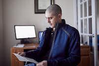 Matt Gleason looks over a bill he received from Atrium Health.(Logan Cyrus/Kaiser Health News)