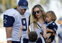 Dallas Cowboys quarterback Tony Romo (9) and his wife  Candice Crawford corral their kids Hawkins (left) and Rivers following afternoon practice at training camp in Oxnard, Calif. on Aug. 5, 2016. (Tom Fox/Staff Photographer)
