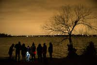 People looking to see if White Rock Lake is haunted, explore the lake with Haunted Rooms in Dallas on Friday, December 14, 2018. The group used various equipment to detect if ghosts were in the area. (Daniel Carde/The Dallas Morning News)(Daniel Carde/Staff Photographer)