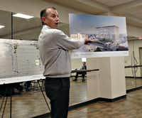Here is Robert Dozier showing off his renderings Thursday night. Yes. That's Preston Center.(Robert Wilonsky/Staff writer)