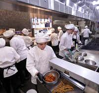Students prepare food for Blu Community Bistro at Allen High School in Allen.(Jason Janik/Special Contributor)
