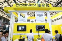 People visited the stand of American machine vision systems supplier Cognex during the 2014 Shanghai International Automotive Manufacturing Technology & Material Show n Shanghai.(Weng lei/Weng lei - Imaginechina)