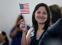 Julieta Chiquillo teared up after taking the Oath of Allegiance for her U.S. citizenship at the U.S. Citizenship and Immigration Services in Irving in 2016.(Rose Baca/Staff Photographer)