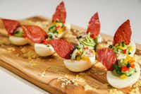 Avocado stuffed deviled eggs topped with baked prosciutto leaves(Ryan Michalesko/Staff Photographer)