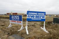 Signs for a new Ross Dress For Less and Five Below that will be part of a large shopping complex under construction across the street from the Buc-ee's in Terrell(Brian Elledge/Staff Photographer)