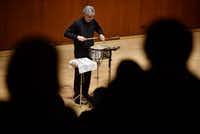 Drew Lang plays <i>Swerve</i> by Gene Koshinski on a snare drum during the Voices of Change Contemporary Chamber Music Ensemble concert.(Ben Torres/Special Contributor)