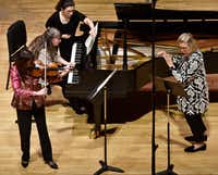 "<p><span style=""font-size: 1em; background-color: transparent;"">Violinist Maria Schleuning, pianist Liudmila Georgievskaya and flutist Helen Blackburn perform Trio for flute, violin and piano (1958) by Nino Rota during a concert by Voices of Change Contemporary Chamber Music Ensemble on Feb. 4, 2019, on the campus of Southern Methodist University in Dallas.</span></p>(Ben Torres/Special Contributor)"