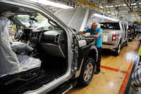 A United Auto Workers assemblyman works on a 2018 Ford F-150 truck being assembled at the Ford Rouge assembly plant in Dearborn, Mich. (Carlos Osorio/The Associated Press<br>)