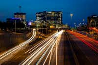 A long exposure shows traffic on the Dallas North Tollway at Tennyson Parkway in Plano.  (Smiley N. Pool/Staff Photographer)