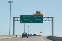 Vehicles travel on the exit ramp from Sam Rayburn Tollway on Wednesday in Lewisville and reach an interchange for Interstate 35E.(Jeff Woo/DRC)
