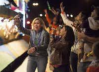 A woman celebrates her bead haul at the Krewe of Centaur parade in Shreveport.(Jim Noetzel)