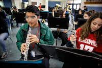 Freshman oboe player David Mojica (left) warms up on his instrument alongside classmate Kelly Valencia in concert band at Duncanville High School on Jan. 31, 2019.  Mojica suffers from aplastic anemia, a blood disorder that could require a bone marrow transplant from a donor. For Latino patients clinging to life, like David, there's a desperate need to find bone marrow donors of Hispanic origin.(Tom Fox/Staff Photographer)