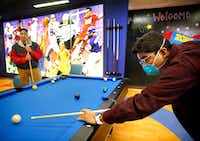 David Mojica, 14, of Duncanville (right) plays pool with his older bother Erick Padilla at Children's Medical Center Dallas on Jan. 17, 2019. Mojica suffers from aplastic anemia, a blood disorder which could require a bone marrow transplant. For patients clinging to life, like David, there's a desperate need to find bone marrow donors of Hispanic origin. (Tom Fox/Staff Photographer)