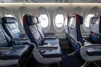 Economy class (left) and Comfort+ (center and right) rows of seating on Delta's new Airbus A220-100 airplane.(Smiley N. Pool/Staff Photographer)