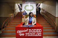 DaNae Lowe and fellow Junior League of Fort Worth members hawk rodeo programs from their red perches lining the concourse of Will Rogers Memorial Coliseum.(Tom Fox/Staff Photographer)