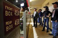 Hand-painted box sections line the wall circling Will Rogers Memorial Coliseum during the PRCA rodeo, Saturday, February 2, 2019 as cowboys and girls watch the rodeo from whats known as 'the wall', a standing room only area.(Tom Fox/Staff Photographer)