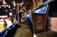 The WRMC (Will Rogers Memorial Coliseum) logo aisle seats have seen better days. Crews clean up after a PRCA rodeo event as the clock ticks down on the last of the events in the coliseum, Friday, February 1, 2019.(Tom Fox/Staff Photographer)