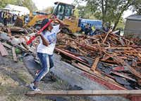 In October 2017, Cynthia King, great-aunt of Shavon Randle, takes a sledge hammer to put the finishing touches on the demolition of the structure at 2208 E. Kiest Blvd. in Oak Cliff south of Dallas, where the body of 13-year-old Shavon Randle was found in July 2017. Randle was kidnapped and held for ransom in a scheme involving drugs, robbery and money in July 2017.(Louis DeLuca/Staff Photographer)
