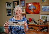 Tarrant County historian Carol Roark poses with collector Larry Schuessler's Panther City memorabilia at Schuelssler's Fort Worth home.(2018 File Photo/Staff)
