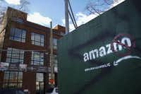 Someone has spray-painted a protest message against Amazon  on a wall near a construction site  in the Long Island City neighborhood of New York City's Queens borough.(Drew Angerer/Getty Images)
