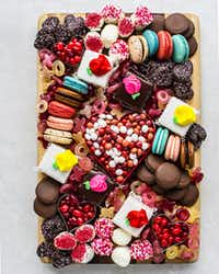 Petits fours, macarons, jelly beans and more comprise a Valentine's Day dessert board(Rebecca White/Special Contributor)